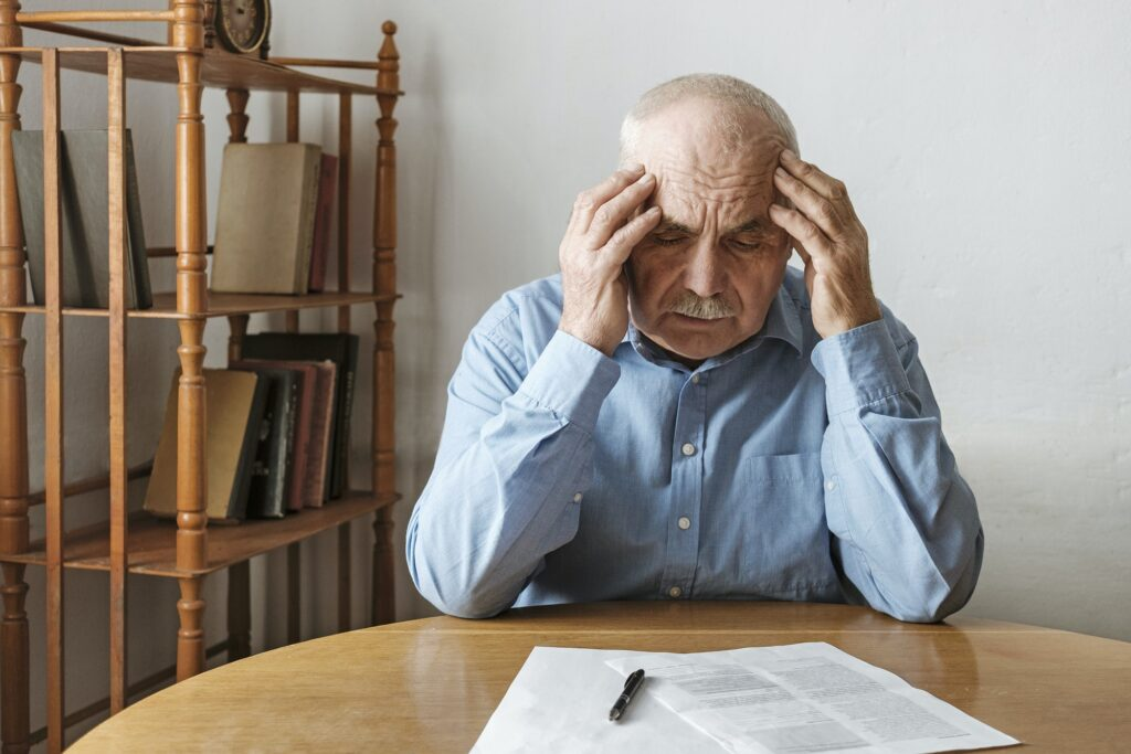 Depressed worried man looking at a form
