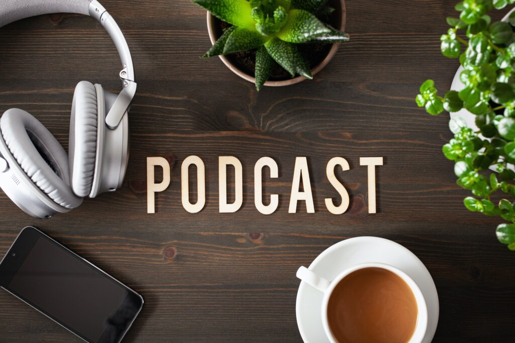 podcast word text concept modern wireless headphones smartphone